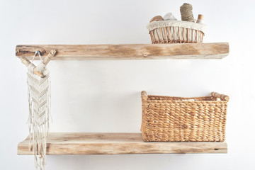 Wooden shelves with decor items. Home interior. Macrame