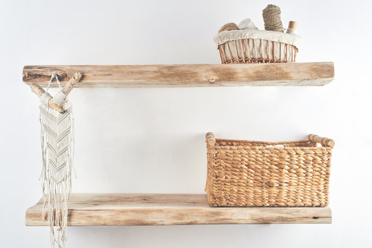 Wooden shelves with decor items. Home interior. Macrame