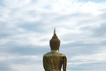 Behind the Buddha statue and the sky with Copy space.