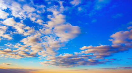 Beautiful contrast clouds and blue sky with yellow gradient before sunset background. Nature weather, cloud blue sky and sun