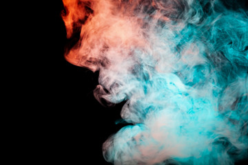 Dynamic puffs of blue gray and orange colors on a black background smoothly flow coloring waves...