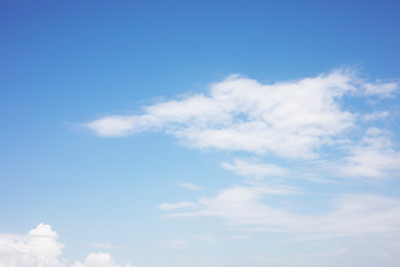 Fluffy blue sky background and white clouds soft focus, and copy space