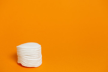 Stack of white cotton sponge pads with copyspace