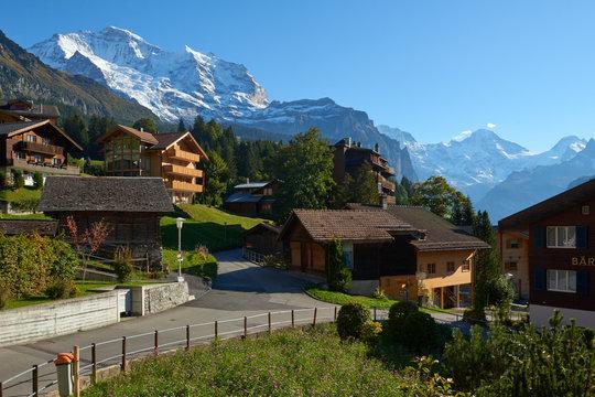 Jungfrau mountain view from the street of Wengen village in Switzerland.