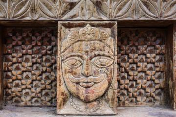 Papiers peints Edifice religieux Vashisht, India - May 27, 2017: Traditional wooden carving on the hindu temple in Vashisht village in Kullu valley, Himachal Pradesh, India