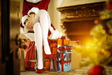 Slim young woman legs and christmas time