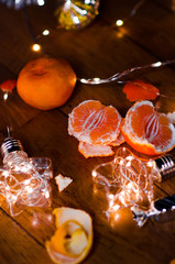 Tangerines and beautiful lights and bokeh in the background .New year. Christmas card