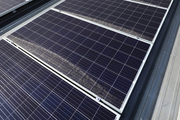Dirty Dusty Photovoltaic Panels on Roof