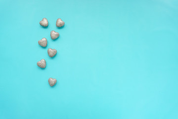 Happy women's day or valentine's day with brilliant hearts on romantic blue light background.