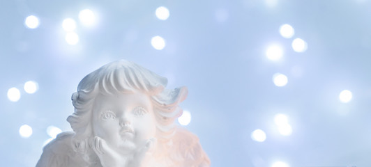 White christmas - cute angel with bokeh lights in background banner