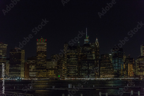 Fototapete Manhattan skyline panorama with Times Square lights at dusk, New York City