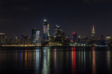 Wall Mural - Manhattan skyline panorama with Times Square lights at dusk, New York City