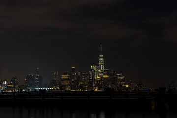 Fototapete - Manhattan skyline panorama with Times Square lights at dusk, New York City