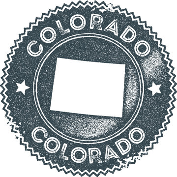 Colorado map vintage stamp. Retro style handmade label, badge or element for travel souvenirs. Dark blue rubber stamp with us state map silhouette. Vector illustration.