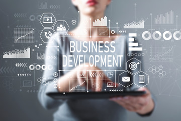 Business development with business woman using a tablet computer