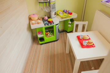 Green baby retro kitchen in children's room. Children's room