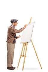 Senior male artist painting on a canvas