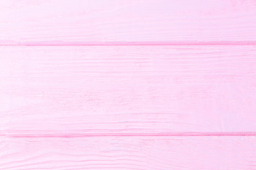Pink wooden background. Wooden textured background. Copy space for text