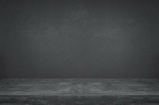 Empty grunge dark cement wall and table top background