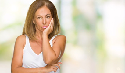 Beautiful middle age casual adult woman over isolated background thinking looking tired and bored with depression problems with crossed arms.