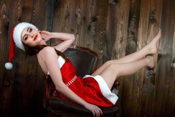 Beautiful smiling female model wear santa hat