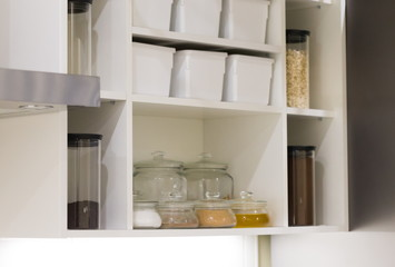 Interior. Jars and and boxes in the kitchen cupboard