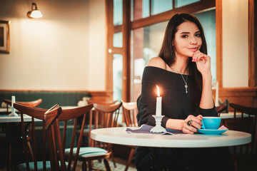 Beautiful woman sitting at the restaurant