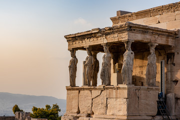 Printed kitchen splashbacks Athens The ancient Erechtheion temple with the beautiful Caryatid pillars on the porch, with a golden glow at sunset, on the Acropolis in Athens, Greece.