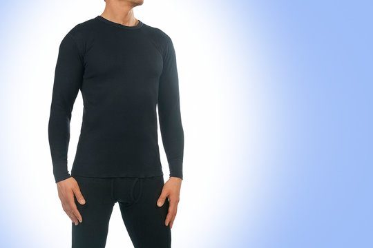 Man in thermal underwear for active winter sport. Man wearing Thermolinen isolated on blue background. T-shirt with long sleeves and leggings