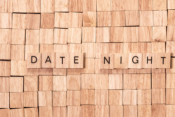 date night spelled out in wooden letters