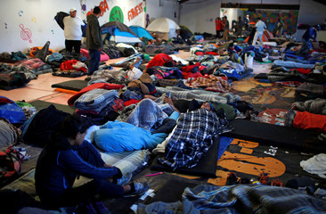 Migrants, part of a caravan of thousands from Central America trying to reach the United States, are seen in a temporary shelter in Tijuana