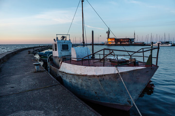 Fishing boats near the pier in the port of Nida. Lithuania.
