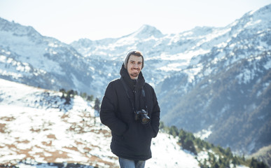 Portrait of photographer in snowy mountains