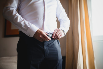 A businessman in a suit. A businessman is preparing to meet with clients.