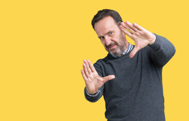 Handsome middle age senior man wearing a sweater over isolated background Smiling doing frame using hands palms and fingers, camera perspective
