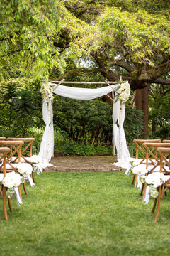 Lace and flower wedding alter at an outdoor ceremony
