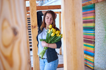 Beautiful woman stands with flowers