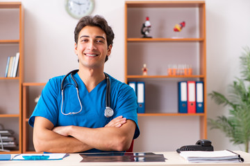 Young handsome doctor radiologyst working in clinic
