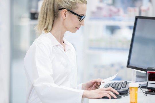 Pharmacist working on computer