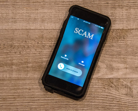 Cell Phone showing call from, Scam