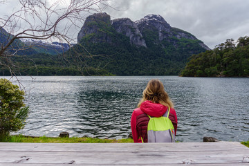 Stunning view of woman against Nahuel Huapi lake, at Puerto Blest in Patagonia, Argentina