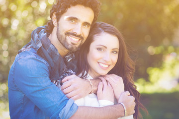 Close up portrait of attractive young couple in love outdoors