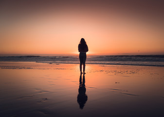 silhouette of woman at sunset in Redondo Beach California right outside of Los Angeles