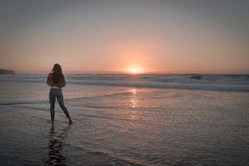 Women watching the beautiful sunset over the Pacific Ocean.  Redondo Beach just outside Los Angeles.