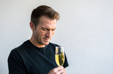 handsome Caucasian man holding a glass of champagne