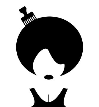woman with afro and comb in hair