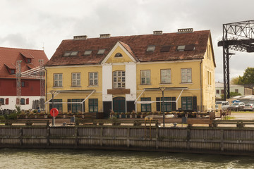 Old historical building near Dane river embankment in center of the Klaipeda (former german name of town is Memel).