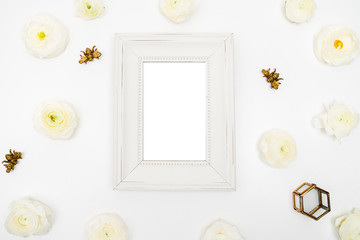 White photo frame with blank space surrounded with ranunculus and golden bees flat lay template