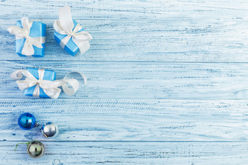 Christmas presents packed with ribbons on wooden background