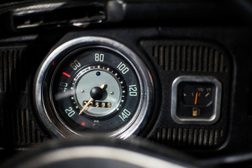 Old car dashboard and instrument claster on dark interior